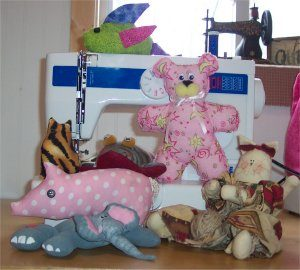 A group of handmade stuffed animals you can sew at summer sewing camp.