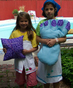 Big foot Pillow and ribbon pillow that the girls sewed, AND their Terry Cloth robes...