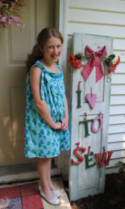 Samantha stitches up her first dress, a cute easy to sew summer sun dress.