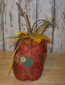 A completed rustic country pumpkin craft that is easy to sew and handmade