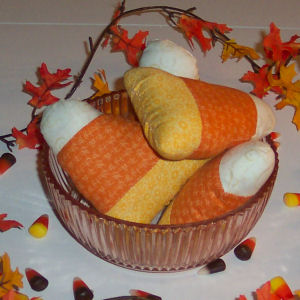 The finished product of candy corn crafts that are easy to sew in a free Halloween tutorial the produces handmade crafts