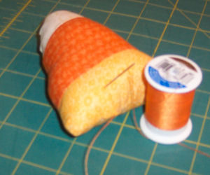 A candy corn craft that is handmade and easy to sew is perfect for Halloween