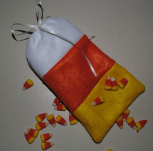A handmade and cute easy to sew Halloween Candy Corn Bag