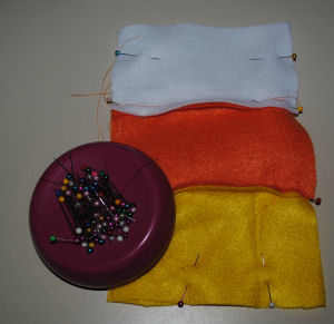 An easy to sew drawstring candy corn bag for Halloween that is handmade