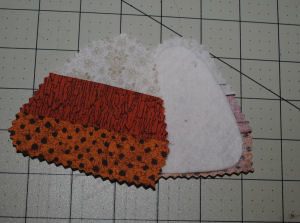 A Halloween craft featuring a candy corn candle ring that is handmade and easy to sew