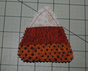 A Halloween candy corn candle ring that is very easy to sew and handmade