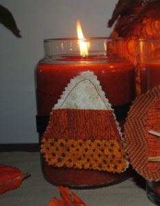 A candy corn candle ring the is a Halloween craft, easy to sew, and handmade