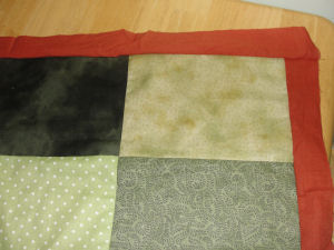 A free tutorial showing how to make a handmade Halloween quilt that is easy to sew