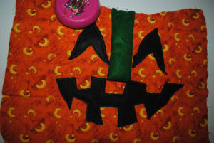 A quilted handmade pumpkin craft for Halloween that is easy to sew