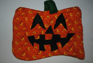An easy to sew quilted pumpkin Halloween that is handmade