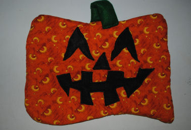 How to Make a Quilted Pumpkin Face Door Hanging Craft
