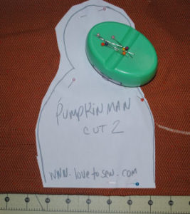 A pumpkinman craft perfect for Halloween that is easy to sew and handmade