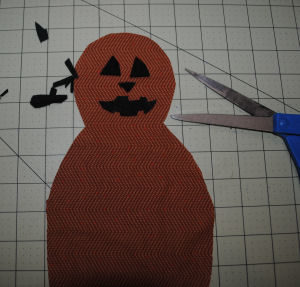 A Halloween Pumpkinman craft that is handmade and easy to sew with a free tutorial