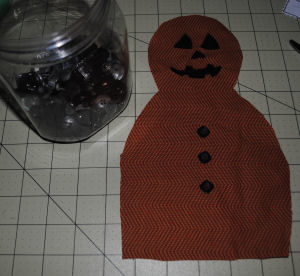 An easy to sew handmade Pumpkinman Halloween craft