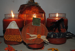 A finished product Halloween pumpkin candle ring that is handmade and easy to sew