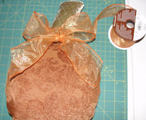 A craft featuring tapestry pumpkins for Halloween that is easy to sew and handmade